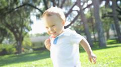 Little Caucasian Boy Toddler Barefoot Outdoors Grass Stock Footage
