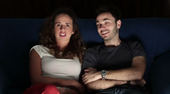 Young Couple Watching Horror Movie Stock Footage