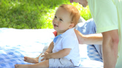 Young Caucasian Father Sitting Blanket Baby Son Outdoors Stock Footage