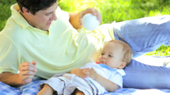 Laughing Baby Boy Lying Rug Outdoors Park - stock footage