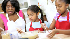 Close Up Little Ethnic Girls Helping Learning Bake Cakes Stock Footage