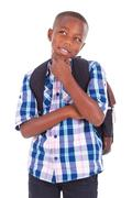 african american school boy looking up - black people - stock photo