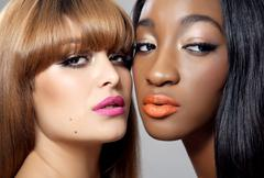 Two beauties with perfect skin Stock Photos