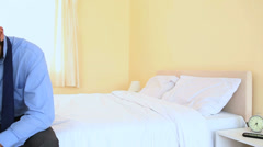 Business crying on bed Stock Footage