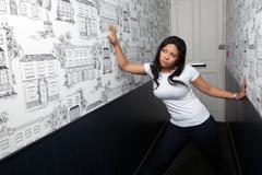 portrait of a woman in corridor - stock photo