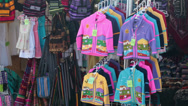 Stock Video Footage of Carnival outdoor flea market clothing sales HD 9618