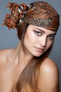 beauty with a head scarf - stock photo