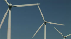 Close up blue sky and wind turbines Stock Footage