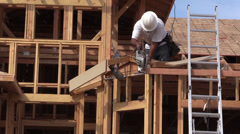New Home Construction, builder sawing Stock Footage