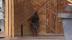 New Home Construction, carpenter hammering Stock Footage