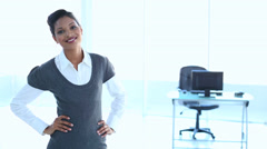 Businesswoman put hands on her hip Stock Footage