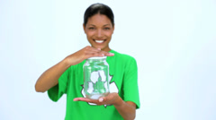 Ecological woman holding jar and does thumbs up at camera Stock Footage