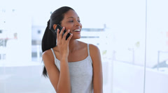 Beautiful woman calling someone with her mobile phone Stock Footage