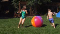 Kids play in sprinkler - stock footage