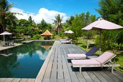 Swimming pool at an eco resort Stock Photos