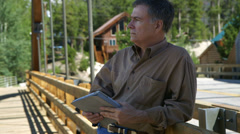 Man in a rural area using a tablet pc Stock Footage