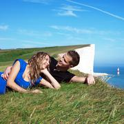 happy couple on the edge of a cliff - stock photo