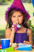 Girl earting cake Stock Photos