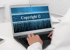 Stock Photo of laptop computer with copyright message on the screen