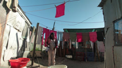 African woman hangs up washing Stock Footage