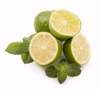 Fresh limes, mint leaves - stock photo