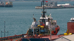Work boat in Gibraltar harbor Stock Footage