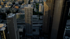 Aerial sunset view with sun flare Columbia Center Downtown Seattle USA Stock Footage