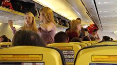 People boarding luggage on plane Stock Footage