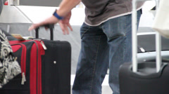 People collecting luggage at airport 3 Stock Footage