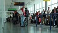 Stock Video Footage of people wait at gate to board plane