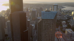 Stock Video Footage of Aerial sunset view with sun flare Columbia Center Downtown Seattle USA