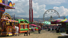State Fair amusement rides carnival family HD 9609 Stock Footage