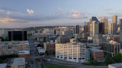 Aerial low level view sunset city office blocks and apartments, Seattle, USA Stock Footage