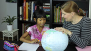 Stock Video Footage of Homeschool Mom Teaching Geography Lesson To Daughter