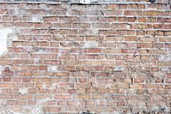 Weathered Olde Red Brick Wall Background - stock photo
