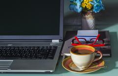 Laptop with coffee cup Stock Photos