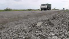 Old Kamaz truck on bad tarmac in Turkmenistan - stock footage
