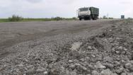 Stock Video Footage of Old Kamaz truck on bad tarmac in Turkmenistan