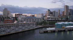 Aerial low level dusk view downtown Seattle Pike Place fish Market, USA Stock Footage
