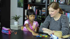 Homeschool Mom Teaching A Math Lesson With Daughter Stock Footage