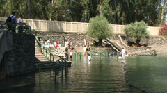 People being baptised Jordan river Israel Stock Footage