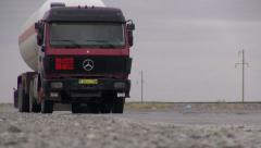 Gas truck drives over highway in desert of Turkmenistan Stock Footage
