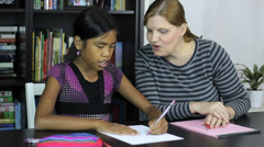 Homeschool Mom Teaches Art Lesson To Daughter Stock Footage