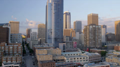 Aerial low level view at sunset Seattle city blocks and Skyscrapers, USA Stock Footage