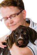 Puppy and woman Stock Photos