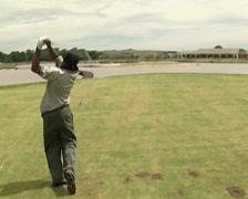 Black Golfer tee-off on Golf Estate PAL - stock footage