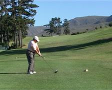Golfer tee-off on Golf Estate PAL - stock footage