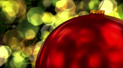 Red Ball Christmas Decoration hanging on a Christmas Tree Stock Footage