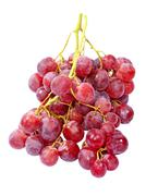Fresh pink grape taken closeup.isolated. Stock Photos
