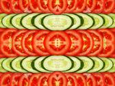Stock Photo of slices of tomatoes and cucumbers as background.